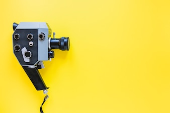 Vintage camera on yellow