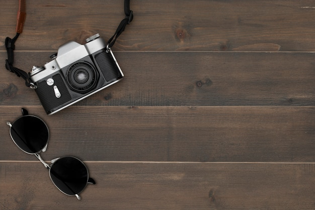 Vintage camera and sunglasses
