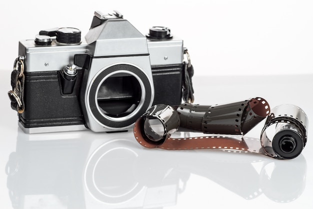Vintage camera with a 35mm film on white