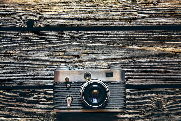 Vintage camera on wooden background and