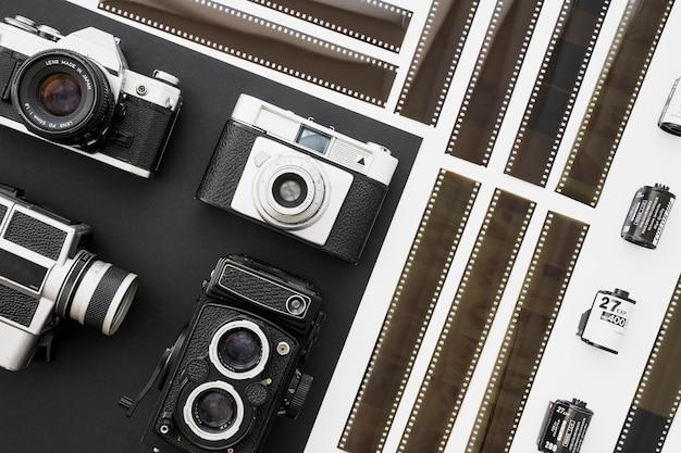 Vintage cameras near filmstrips