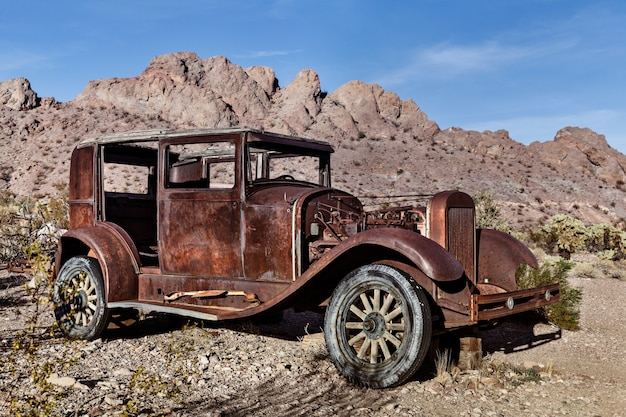 Vintage car in desert by mountain nevada usa