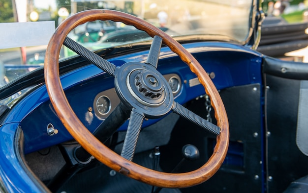 Vintage car detail, antique car steering wheel