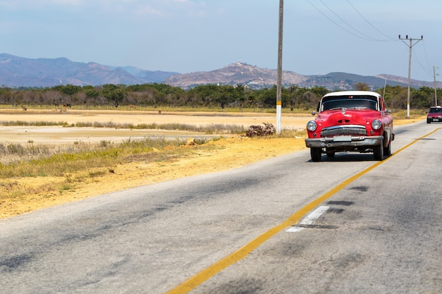 Vintage car driving in cuba