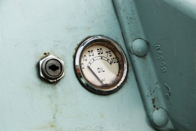 A vintage car oil gauge indicator.