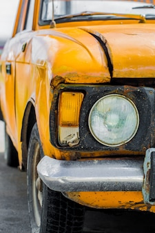 Vintage car yellow. closeup. broken.