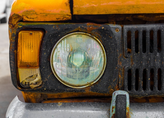 Vintage car yellow. closeup. broken.