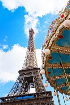 Vintage carousel at the eiffel tower, paris, france, retro toned