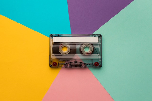 Vintage cassette tape on colourful background