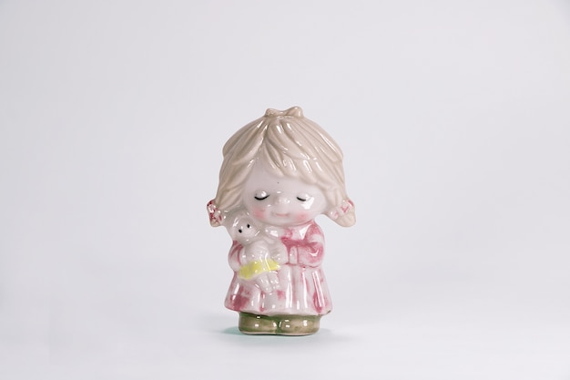 Vintage ceramic doll of sweet cute girl for interior decoration white background.