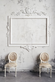 Vintage chairs on textured victorian marble wall