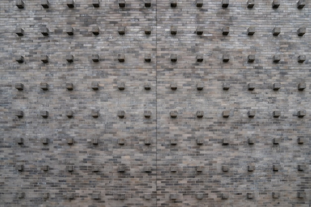 The vintage classic old cube brick stone block on the wall with the tile and seamless pattern.