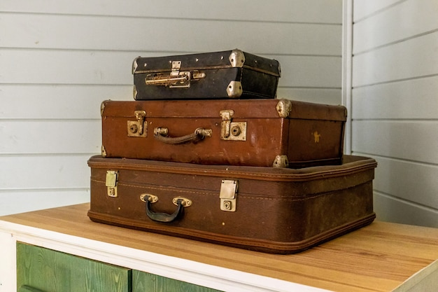 Vintage classic outdated trunks luggage, old antique leather suitcases.