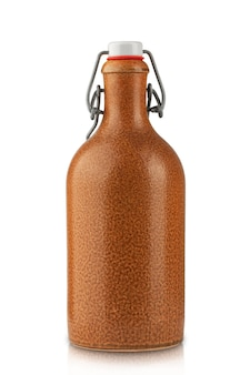 Vintage clay wine bottle with rubber stopper isolate on a white background