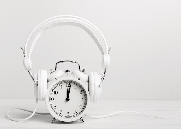Vintage clock listening music through headphones