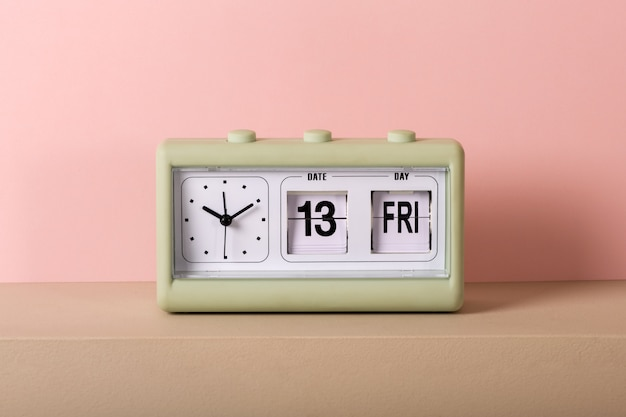 Vintage clock with calendar showing friday 13th