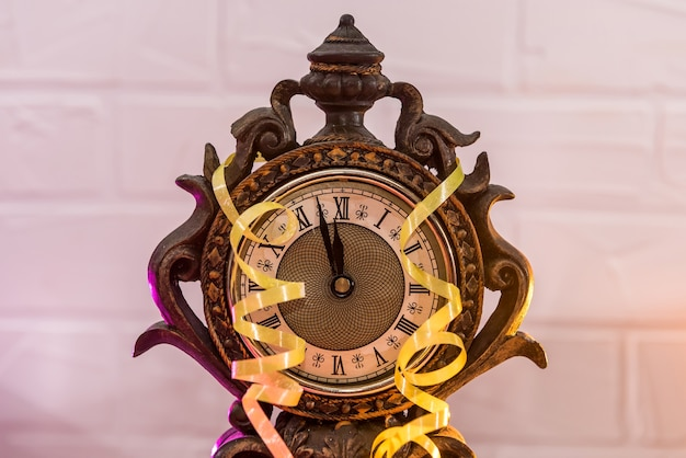 Vintage clock with colorful serpentine stripes and gift boxes. new year concept