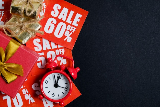 Vintage clock with gift boxes on red stickers with discounts