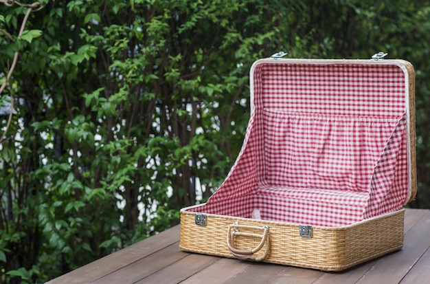 Vintage clothing bag put on a wooden table