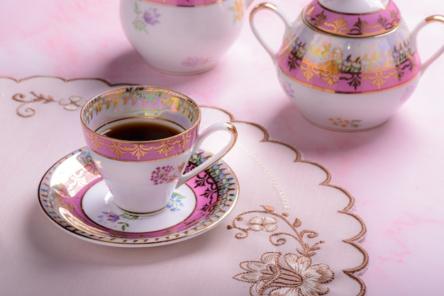 Vintage coffee cup over pink marble