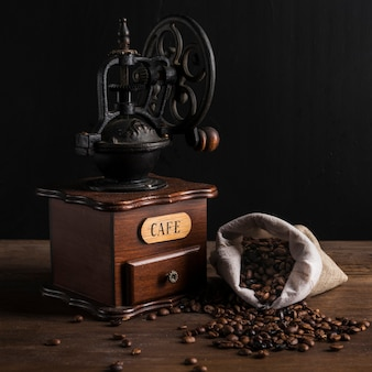 Vintage coffee grinder and sack