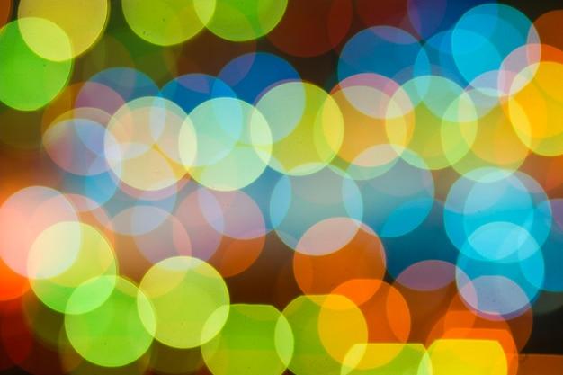 Винтажный цветной фон боке. расфокусированные абстрактные мягкие огни. размытый элемент дизайна света. праздничный несфокусированный фон. элегантный тонированный ретро образ. красочные яркие круги.