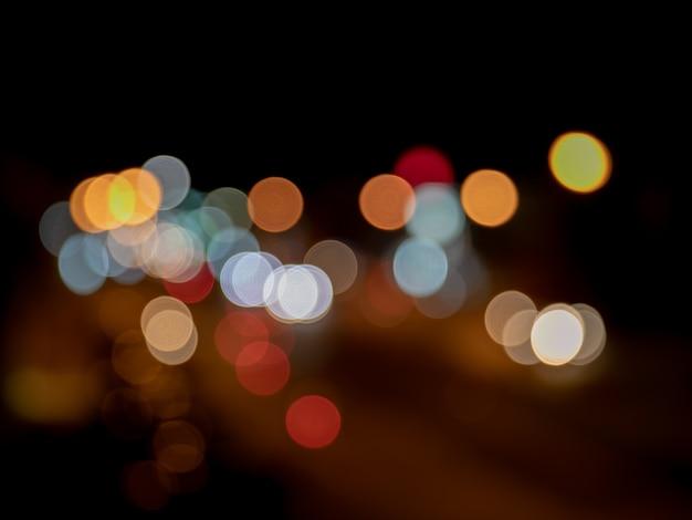 Vintage color bokeh in night light traffic jam