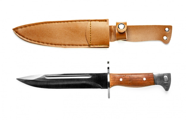 Vintage combat knife bayonet and brown leather scabbard isolated on white.