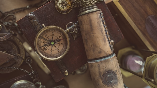 Vintage compass and telescope