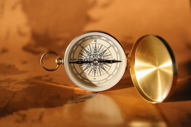 Vintage compass on world map