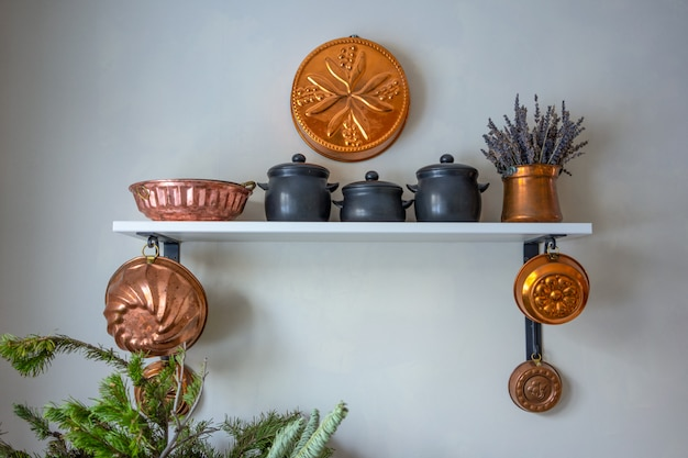 Vintage copper baking molds as wall decorations.
