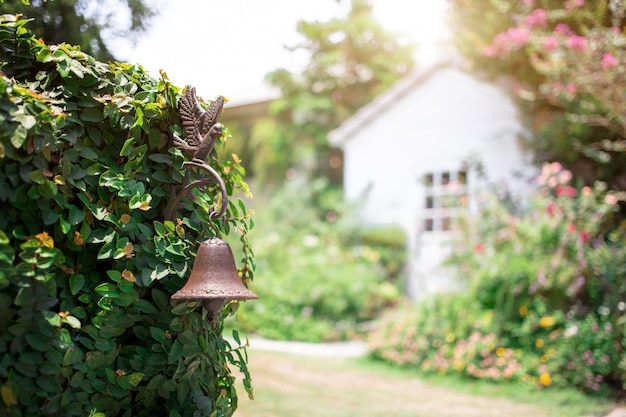 Vintage copper bell decoration plant wall gate vintage house with garden