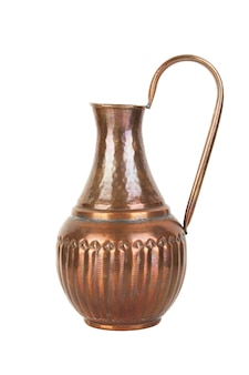 Vintage copper jug isolated on white