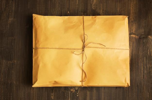 Vintage craft paper envelope tied up with string