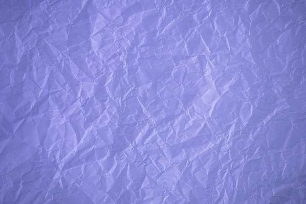 Vintage crumpled paper background, grunge purple texture. wrinkled, abstract background. crushed page, creasy sheet pattern.