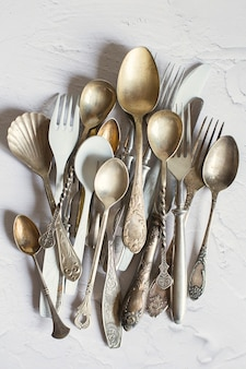 Vintage cutlery on a white table