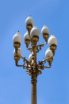 Vintage decorative streetlight on the street