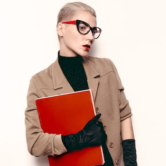 Vintage fashion lady student beige classic costume and stylish accessories. red lipstick, red magazine retro glasses. gloves. love vintage outfit