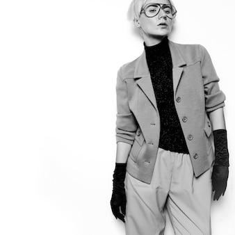 Vintage fashion woman black and white classic suit and stylish eyewear. glam retro style trend autumn winter