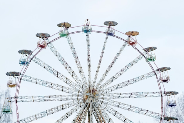 Vintage ferris wheel. colourful old carousel at circus