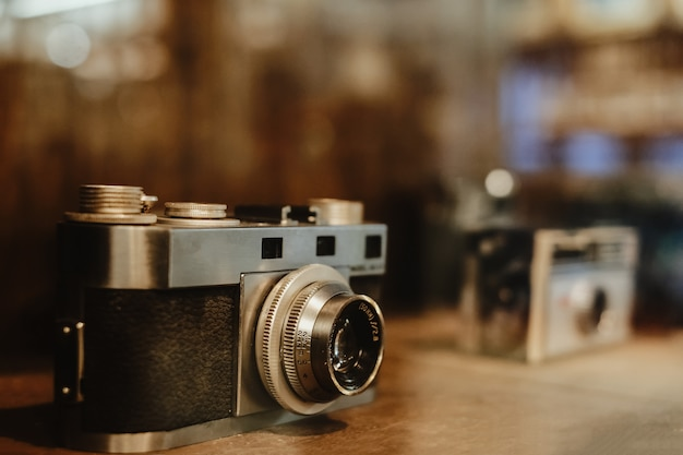 Vintage film camera, collectibles. retro photography equipment. vintage color tone.