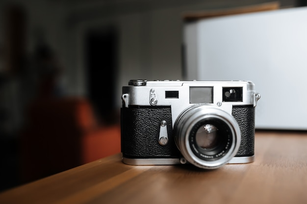 Vintage film camera on a white space
