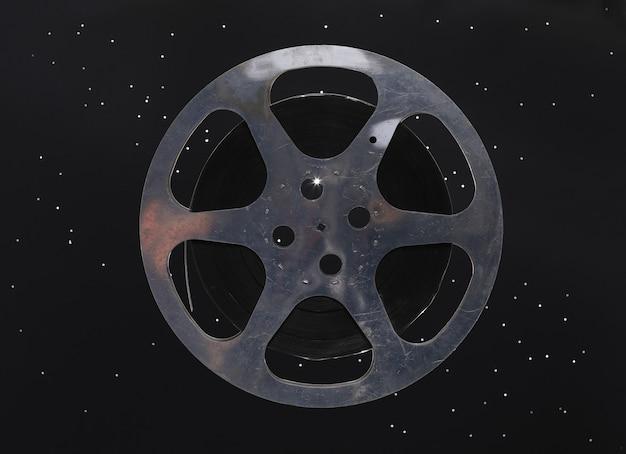 Vintage film reel on black background