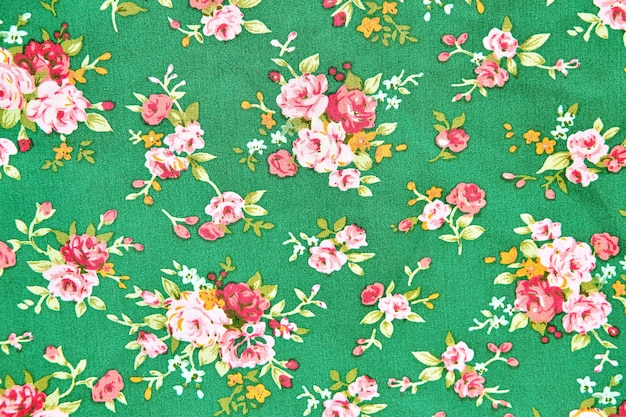 Vintage floral fabric, fragment of colorful retro tapestry textile pattern with floral bac
