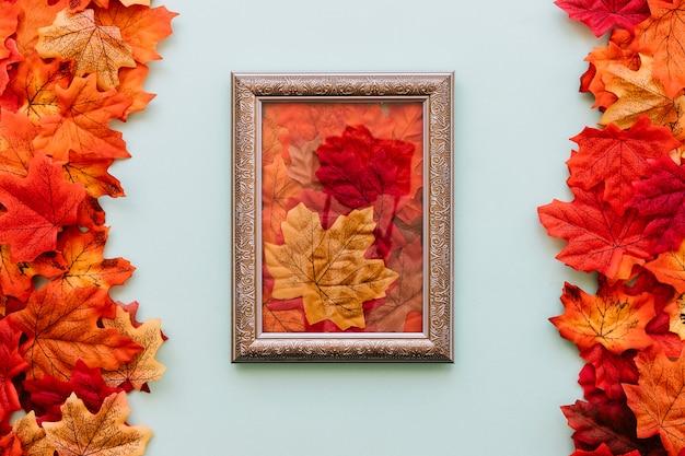 Vintage frame between autumn leaves