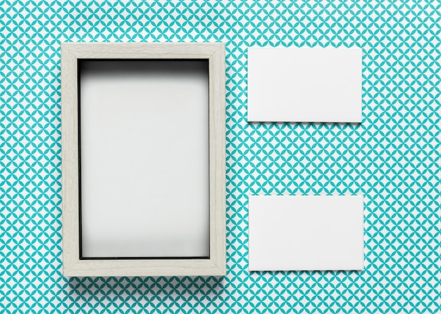 Vintage frame next to blank cardboard