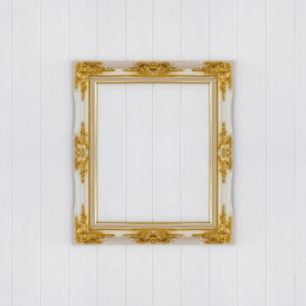 Vintage frame on white wooden wall