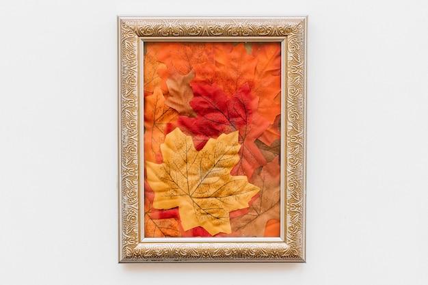 Vintage frame with autumn leave inside