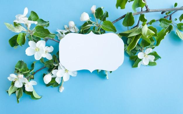 Vintage frame with blossom apple on blue background