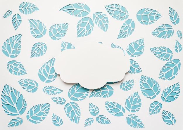 用紙の背景からカットの葉とビンテージフレーム